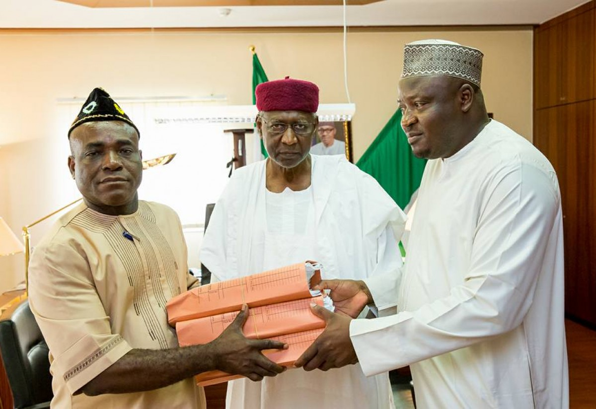 Chief of Staff to President Muhammadu Buhari, Alhaji Abba Kyari receiving 2016 budget from Senior Special Assistants to President on National Assembly Matters, Senator Eta Enang and Honourable Kawu Ismaila at the State House in Abuja on Thursday, April 7, 2016.