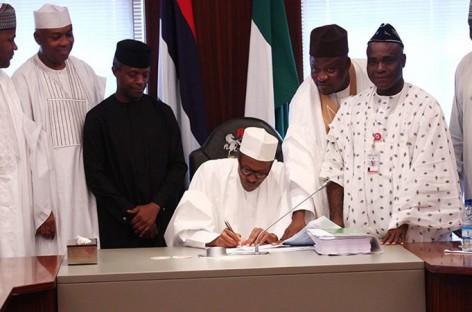 Buhari meets Saraki, signs 8 bills into law