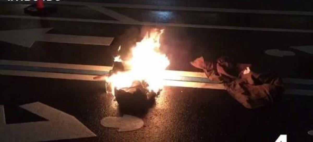 Protester sets himself ablaze outside Trump's hotel