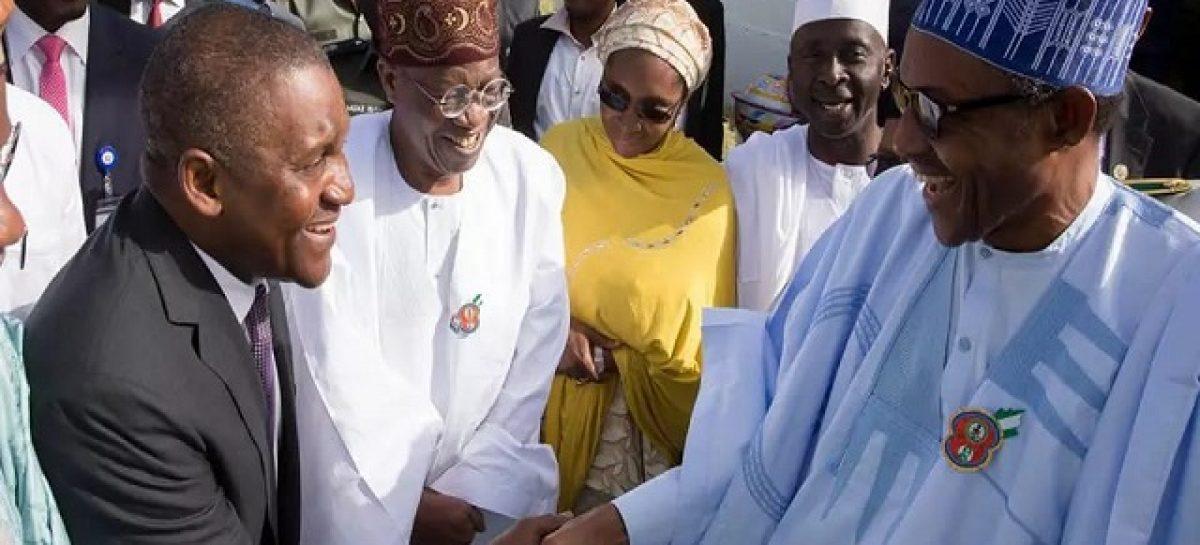Buhari felicitates with Aliko Dangote at 60