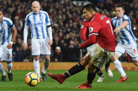 Sanchez scores first goal for United in Huddersfield win