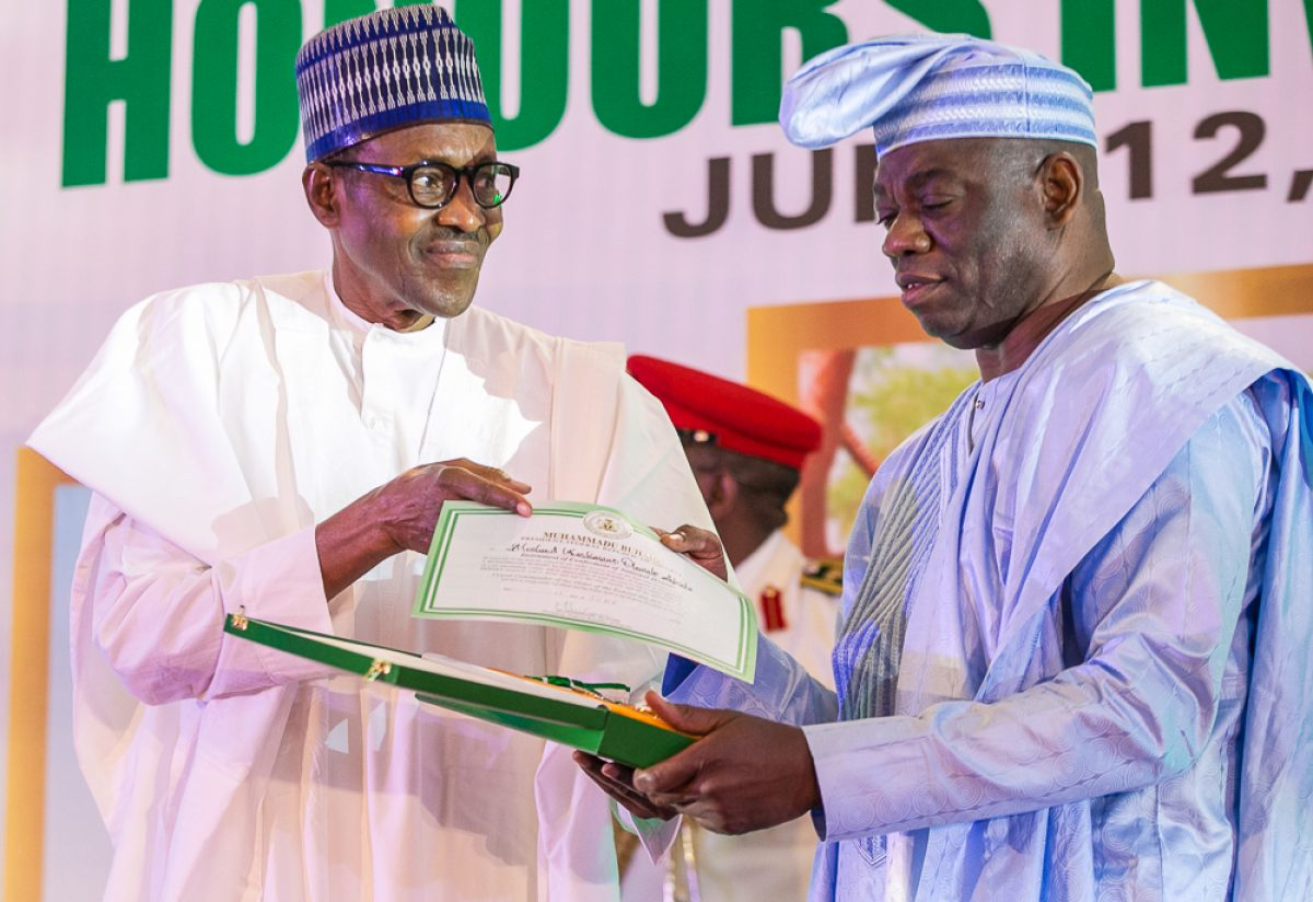 President Muhammadu Buhari declared June 12 Democracy Day and honoured late Chief M.K.O Abiola with national honours award of the Grand Commander of the Order of the Federal Republic (GCFR). His running mate, Ambassador Babagana Kingibe, and late human rights activist and lawyer, Chief Abdul Ganiyu Fawehinmi, with Grand Commander of the Order of the Niger (GCON), at the Presidential Villa, Abuja. PHOTO: State House