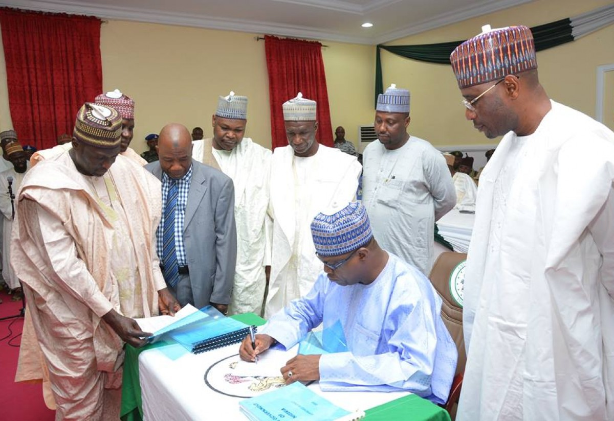 Governor Ibrahim Geidam of Yobe State signing into law the 2016 Finance and Appropriations Bills passed by the State Assembly.