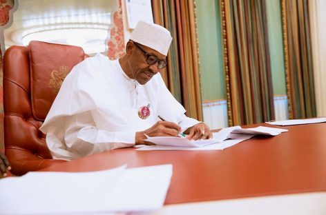 Buhari signs Senior Citizens Act, 7 others into law