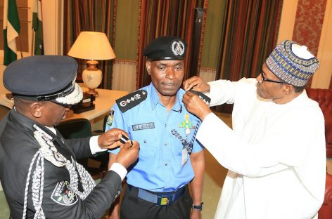 Buhari decorates new acting IGP, Mohammed Abubakar Adamu